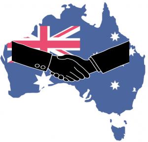 clip art handshake on top of Australian flag map of Australia