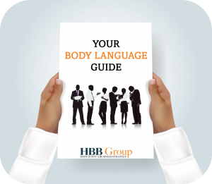 two clipart hands holding a pamphlet with you body language guide written on it above a silhouette of business people and the HBB Group logo Hope is not a business Stategy