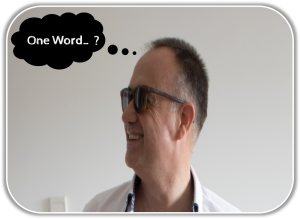 Garret Norris in sunglasses with a thought bubble saying: One Word? for conference activities