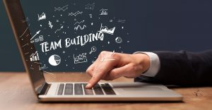 virtual team building image of laptop and hand