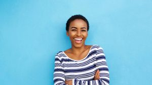 reward smile for positive communication lady with beaming ear to ear smile on blue background