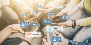 social media sales mobiles in hands with likes everywhere